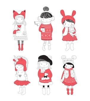 Collezione di ragazze invernali belle e carine disegnate a mano.