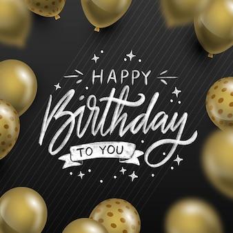 Iscrizione di compleanno disegnata a mano con palloncini dorati realistici