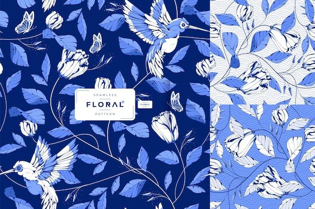 Uccelli di inchiostro blu disegnati a mano e motivo floreale senza soluzione di continuità