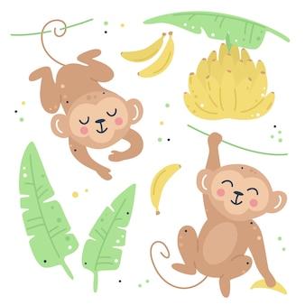 Set infantile disegnato a mano con scimmie, foglie e banane