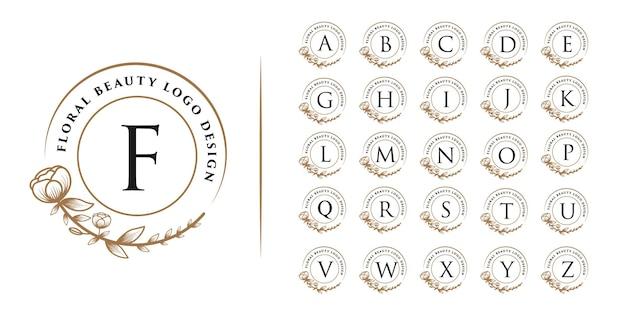 Bellezza femminile disegnata a mano e logo botanico floreale tutte le iniziali della lettera dell'alfabeto per la cura della pelle e dei capelli del salone spa