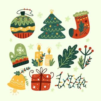 Collezione di elementi natalizi piatti disegnati a mano