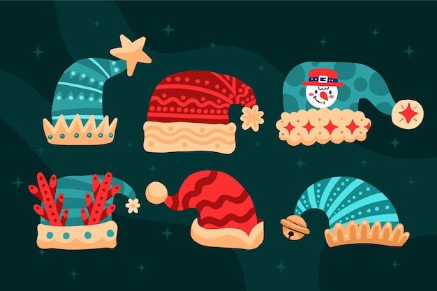 Collezione di cappelli di babbo natale piatti disegnati a mano