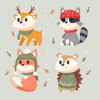 Collezione di animali invernali piatti disegnati a mano