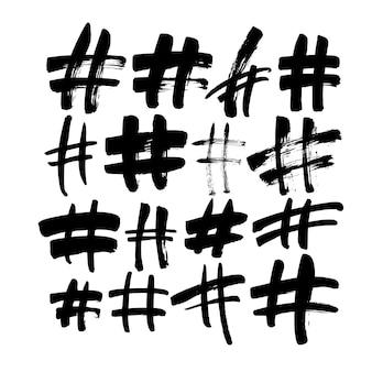 Segni di hashtag disegnati a mano isolati
