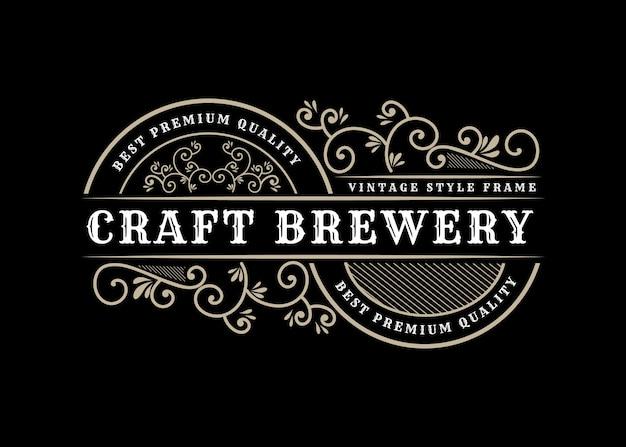Design del logo retrò vintage reale di lusso patrimonio disegnato a mano con cornice decorativa per testo e tipografia