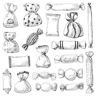 Disegnato a mano un ampio set di diversi dolci in un involucro
