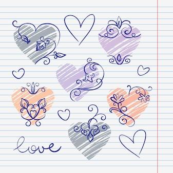 Scarabocchi d'amore disegnati a mano in un album da disegno