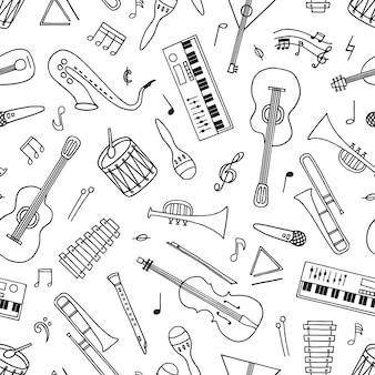 Modello senza cuciture di strumenti musicali disegnati a mano in stile doodle su bianco