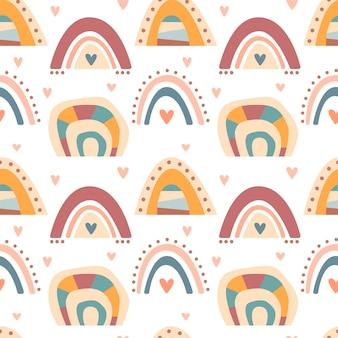 Reticolo senza giunte disegnato a mano di colore pastello carino arcobaleni boho isolato su priorità bassa bianca. illustrazione piana di vettore. design per tessuti per bambini, carta da parati, confezioni, fondali