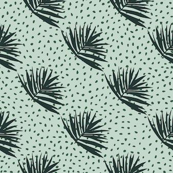 Reticolo senza giunte disegnato a mano con foglie di cespuglio. sfondo azzurro con punti e ornamento fogliame tropicale verde scuro.