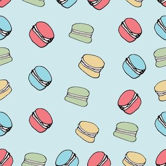 Modello senza cuciture disegnato a mano con macarons colorati