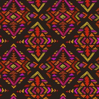 Modello senza cuciture disegnato a mano con elementi astratti tribali