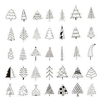 Insieme disegnato a mano di alberi di natale.
