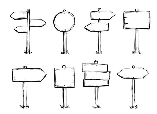 Insieme disegnato a mano del segnale di direzione stradale