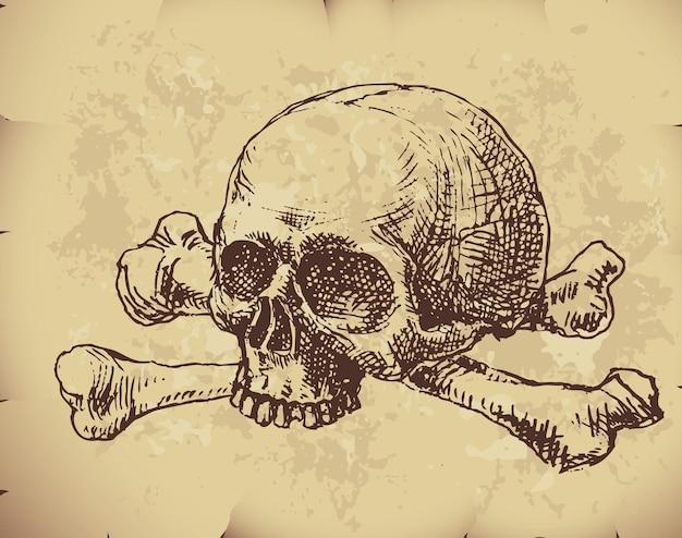 Teschio e ossa incrociate disegnati a mano su carta vecchia