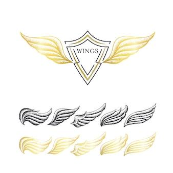 Set di ali punteggiate disegnate a mano. oggetti isolati neri e dorati.