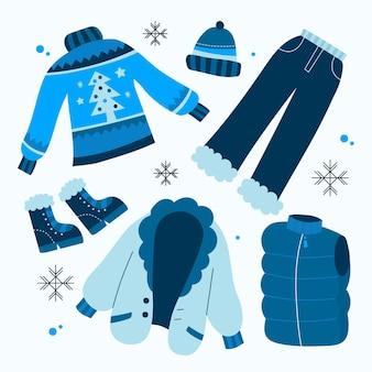 Set di vestiti invernali ed elementi essenziali disegnati a mano