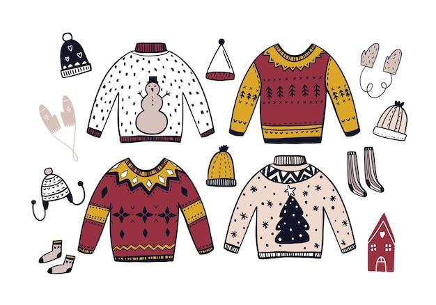 Insieme di vettore di vestiti invernali disegnati a mano in stile scani. scarabocchio