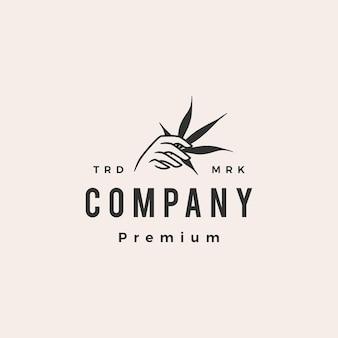 Tenere in mano il logo vintage hipster di cannabis