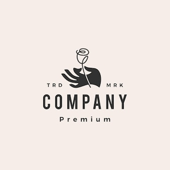 Modello di logo vintage hipster fiore rosa della stretta della mano
