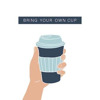 Mano che tiene la tazza di caffè. stile di vita a rifiuti zero.