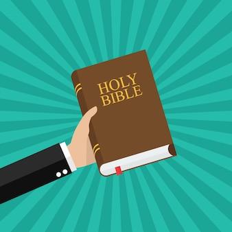 Mano che tiene la sacra bibbia