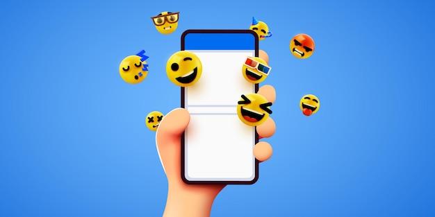 Mano che tiene le emoticon del telefono social media e chat di messaggistica