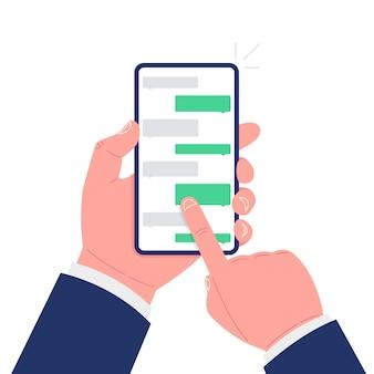 Smartphone della tenuta della mano con l'applicazione con le caselle di chat. illustrazione vettoriale.