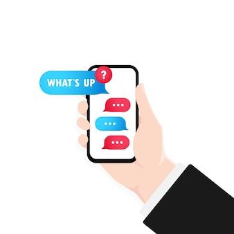 Mano che tiene smartphone con finestra di dialogo e messaggio che cosa succede