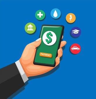 Mano che tiene smartphone con mobile banking app finanziaria