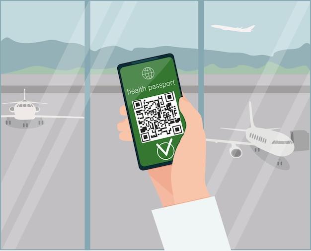 Una mano che tiene uno smartphone con un codice qr, lo stato della vaccinazione. un aeroporto. vettore