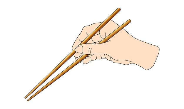 Mano che tiene i bastoncini di sushi per lo schema dei rotoli come mantenere la posizione delle bacchette cinesi asiatiche del giappone