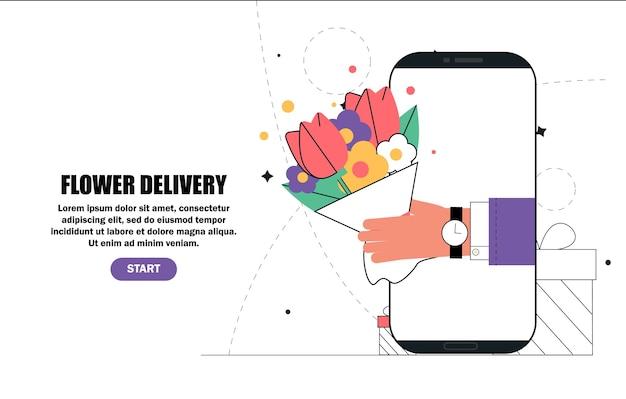 La mano tiene i fiori dallo schermo dello smartphone