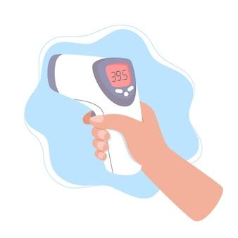 La mano tiene un termometro a infrarossi per misurare la temperatura corporea