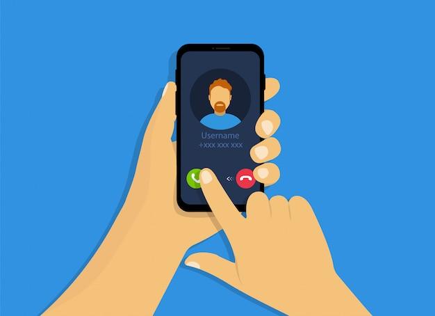Una mano tiene un telefono con una chiamata in arrivo. interfaccia di chiamata in arrivo in stile cartone animato.