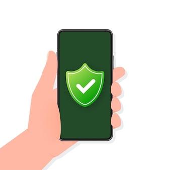 La mano tiene il telefono con segno sicuro sullo schermo su sfondo verde