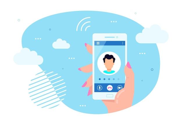 La mano tiene lo smartphone con la chiamata in uscita su uno schermo. chiamare il concetto di servizio.