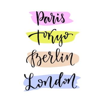 Letteratura a mano. vector moderna calligrafica lettering. le capitali del mondo - parigi tokyo berlino londra