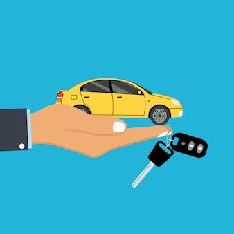 Il palmo della mano tiene l'auto e la chiave con il portachiavi del sistema di allarme sul dito concetto per agente automobilistico