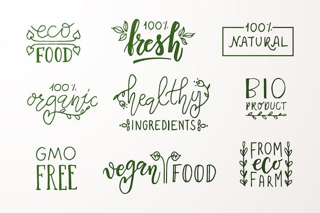 Distintivi ed etichette disegnati a mano con vegetariani vegani crudi eco bio naturali freschi senza glutine ogm