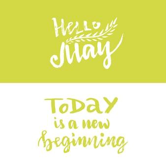 Vector lettering di mano. ciao maggio. oggi è un nuovo inizio