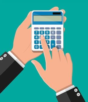 Mano con la calcolatrice. calcoli finanziari, ragioniere.