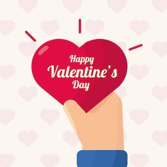 Mano con cuore amore san valentino nel reticolo dei cuori