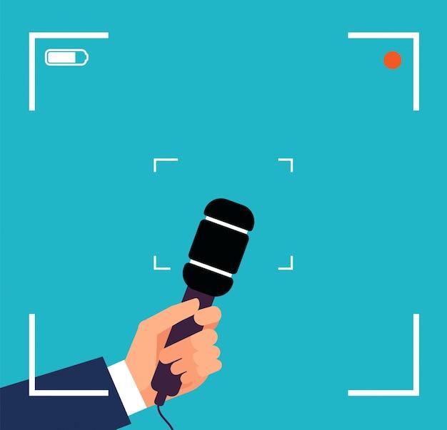 Mano con microfono. intervista tv focus, trasmissione di notizie in diretta con mirino e microfono