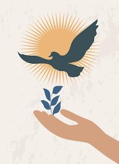 Una mano con una pianta e un uccello in volo