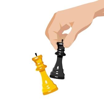 Mano con due figure di scacchi l'uomo gioca a scacchi