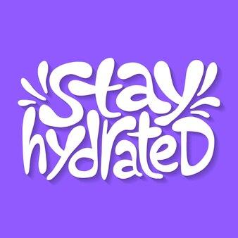 Citazione scritta disegnata a mano rimani idratato slogan stilizzato tipografia