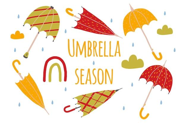 Set di ombrelli disegnati a mano la stagione degli ombrelli concetto autunnale