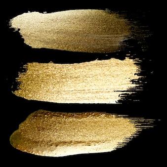 Insieme di set di pennellate di vernice oro fatto a mano